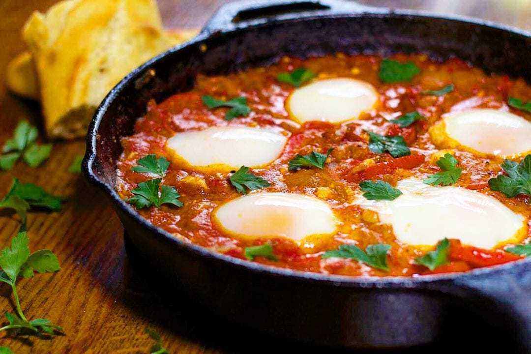 shakshuka with sous vide eggs in cast iron skillet