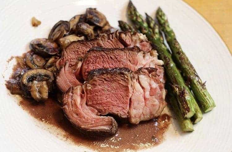Sous vide chuck roast with aus jus and mushrooms